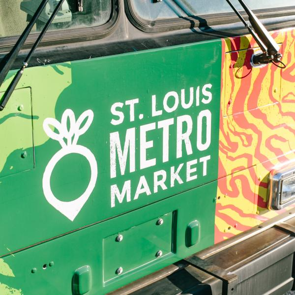 "Rafia Zafar partners with St. Louis Metro Market's ""Food Bus"" on Community Cookbook Project"